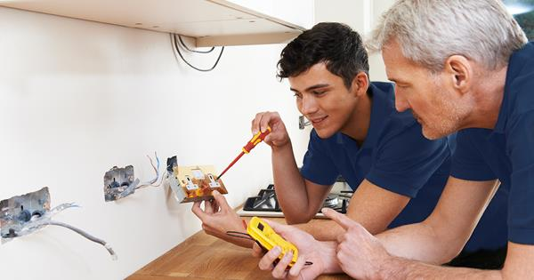 Electrician And Apprentice