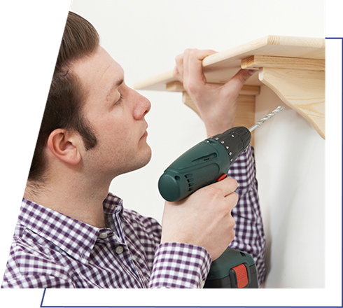 Man Putting Up Shelf